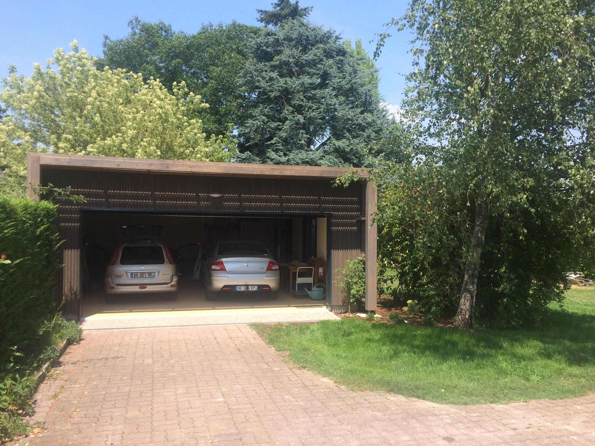 Extension garage toit plat en ossature bois olivet 45210 for Garage toit plat bois