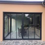 Extension de maison traditionnelle avec une véranda de style atelier